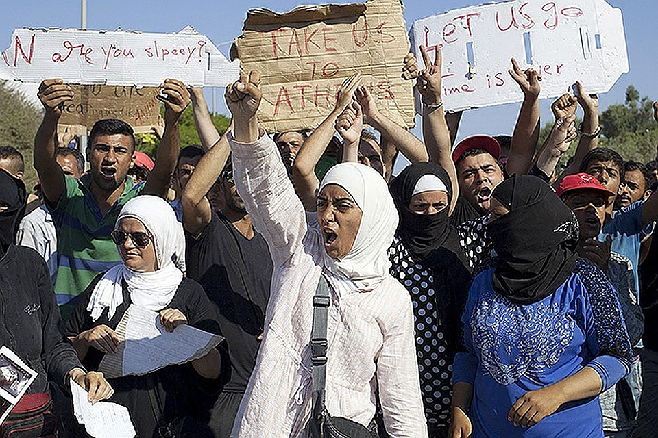 Германия, Греция иИспания достигли договоренности попроблеме мигрантов