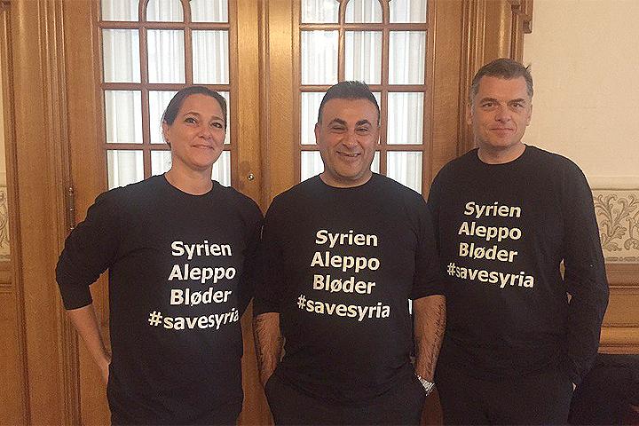 Депутаты датского парламента пришли в законодательное собрание в черных футболках с надписью: «Сирия. Алеппо кровоточит». Фото: с сайта twitter.com