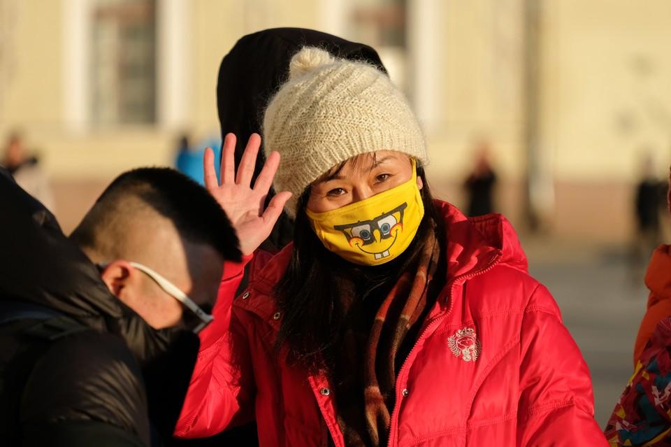 В России сейчас можно встретить множество граждан КНР, гулящих по нашим городам в масках.