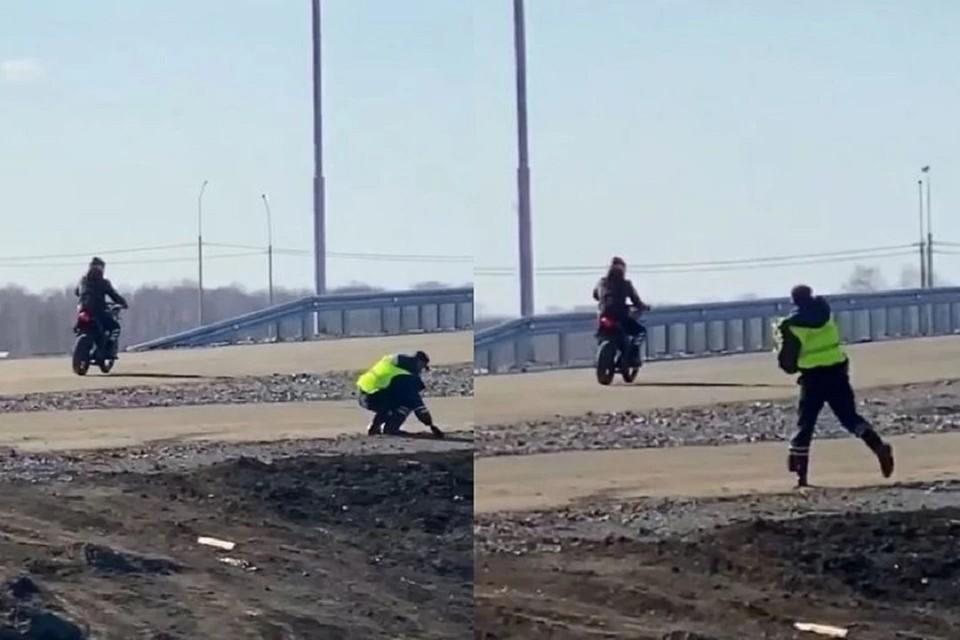 В Новосибирске начальство отчитало полицейского, который кинул камнем в мотоциклиста. Фото: стоп-кадр.