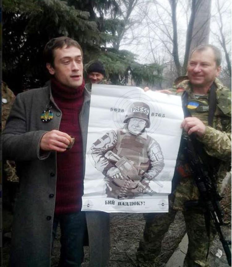 Три года назад Пашинин попозировал вместе с бойцами АТО, держа в руках мишень с изображением Михаила Пореченкова, который открыто поддержал ополченцев