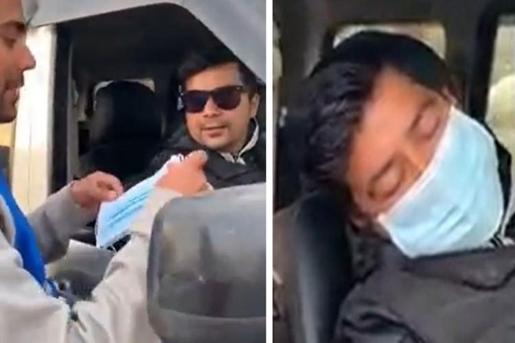 Кадр из популярного видео в Фейсбуке, на котором молодой человек раздает две маски проезжающей мимо паре, а когда те надевают их, ворует с пальца водителя золотое кольцо.