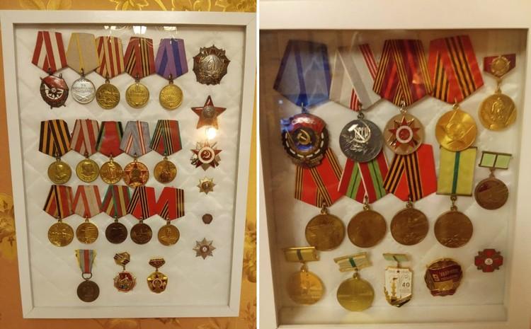 Дома на стене, за стеклом, в красивых рамках, блестят четыре отцовских ордена и 15 медалей, а также мамин орден Трудового Красного Знамени.