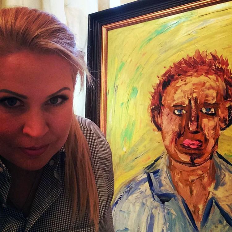 Евгения Васильева с портретом Навального