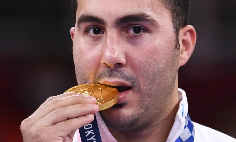 Иранский каратист Саджад Ганджзаде после «отключки» стал олимпийским чемпионом. Фото: Reuters